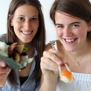 Kate Stoeckle (left) and Louisa Strauss eating sushi.